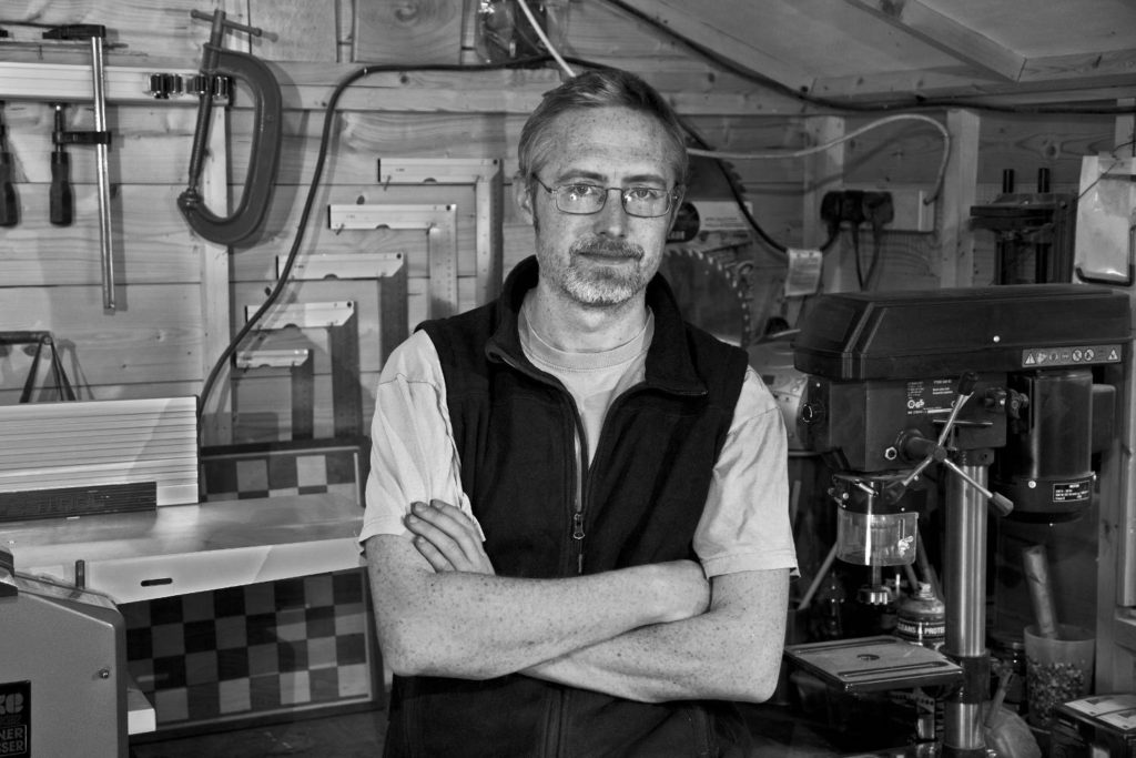 George Moor, wood designer, in his workshop